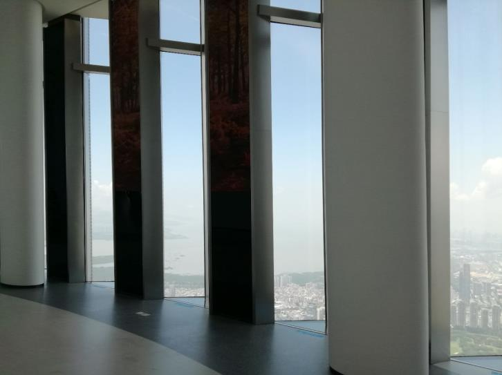 The floor to ceiling windows of the observation deck