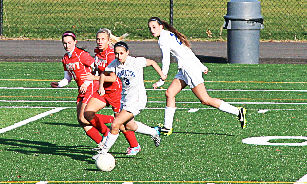 Jordan Provorny '14 dribbling the ball away from Jackson Liberty in the first round of states. The girls won 6-0. Photo courtesy of Lloyd Pawlak.