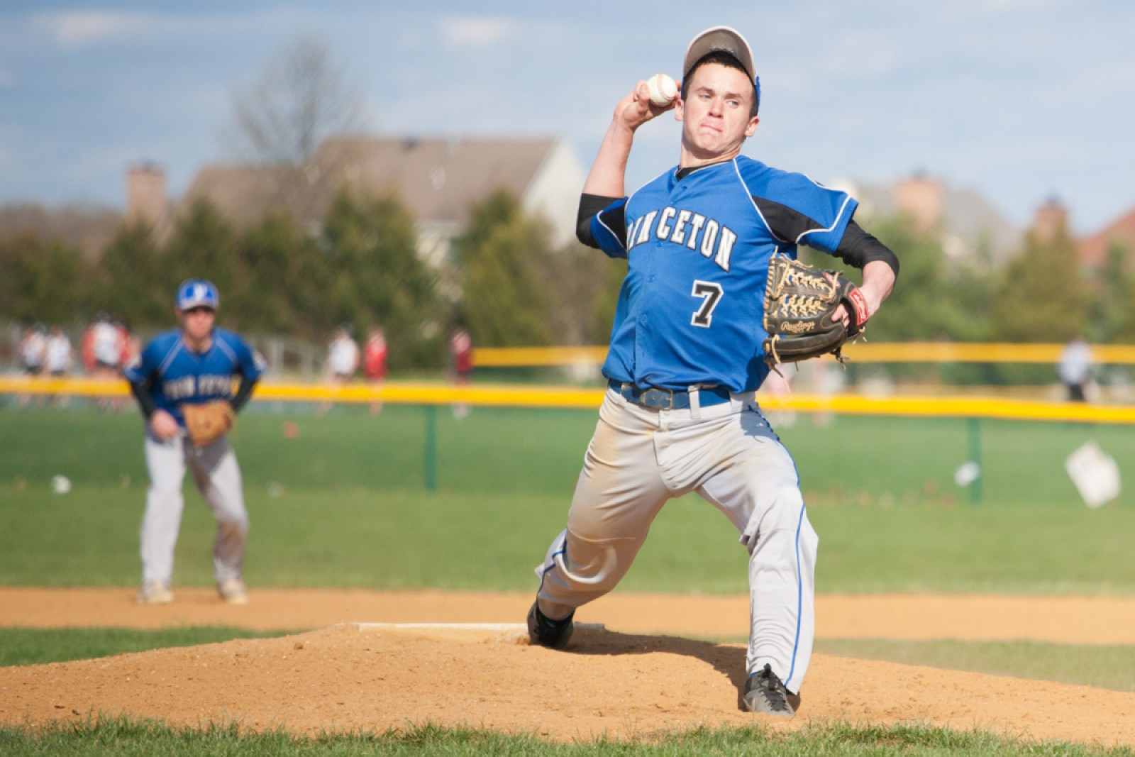 Hayden Reyes '16 pitches against West Windsor-Plainsboro High School North on April 23. Princeton lost 11–0. photo: Ziyi Liu