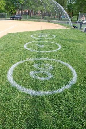 The numbers of the graduating softball seniors are painted onto the grass. photo courtesy: Jessica  Campisi