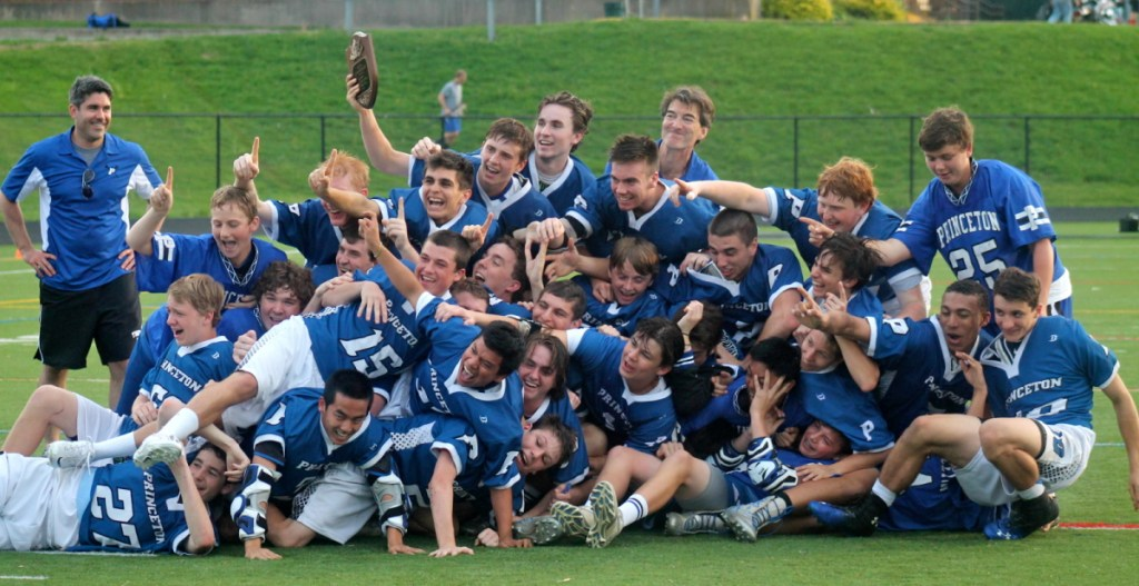Members of the boys lacrosse team pose with their championship plaque after winning the Mercer County Tournament with an 11–10 overtime win over Allentown High School on May 15. photo: Catherine Curran-Groome
