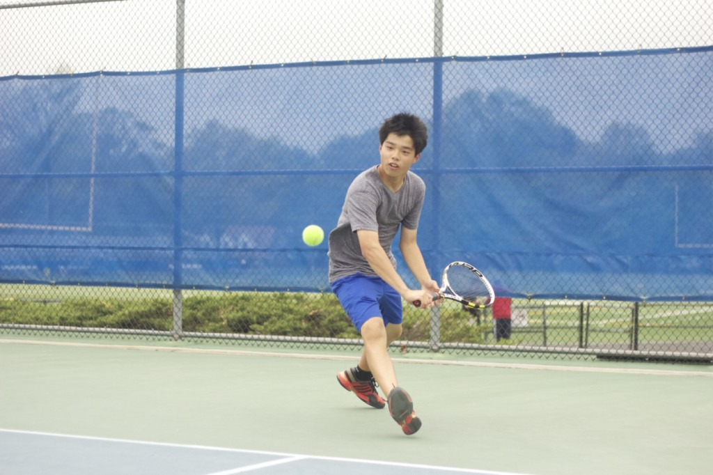 Andrew Wei '16 thrusts forward to hit the ball across the court on May 9. photo: Nathan Drezner