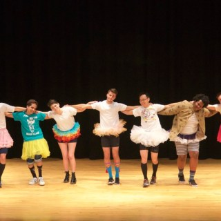 The Mr. PHS contestants stand arm-in-arm during the show's opening act, a collaborative dance choreographed by Caroline DiSimoni '15 in the style of classical ballet. photo: Caroline Smith
