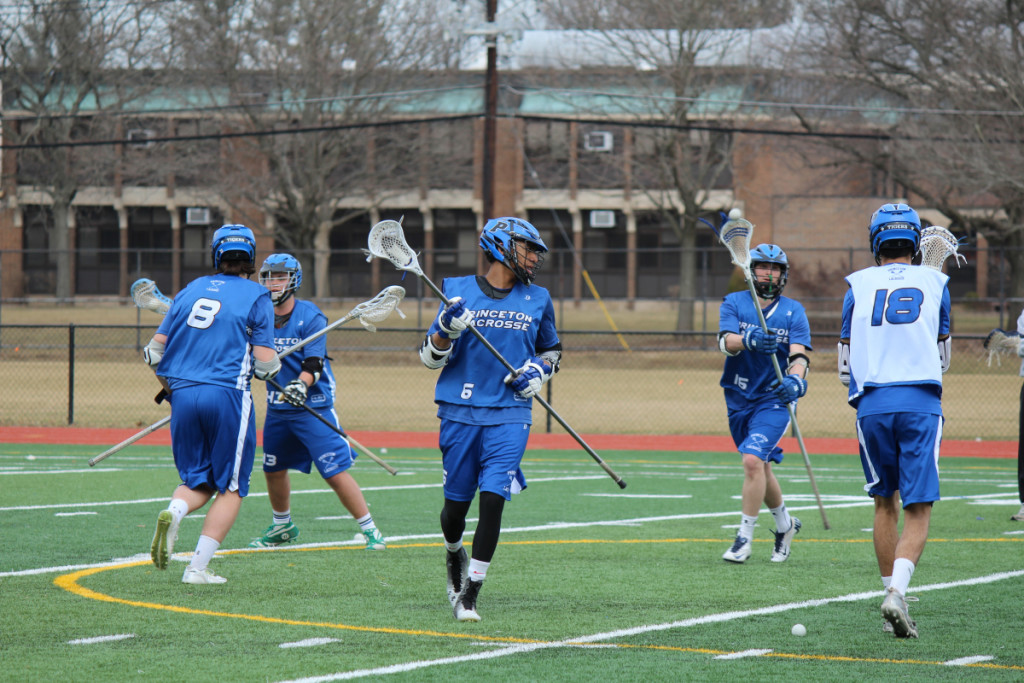Co-Captains Joe Hawes '15 (above) and Jackson Andres '15 (right)  lead team drills at practice on March 15 at the Princeton High School turf. Photo: Shreya Dandamudi