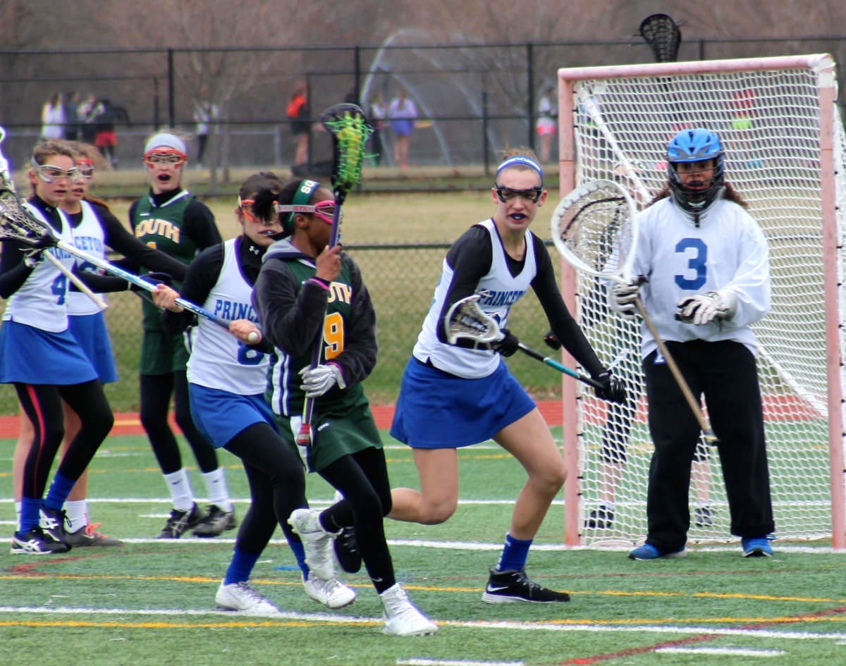 Midfielder Julia Ryan '15 defends against West Windsor-Plainsboro High School South on April 8 at the PHS turf. The team defeated South  20–2.  photo: Ashley Dart