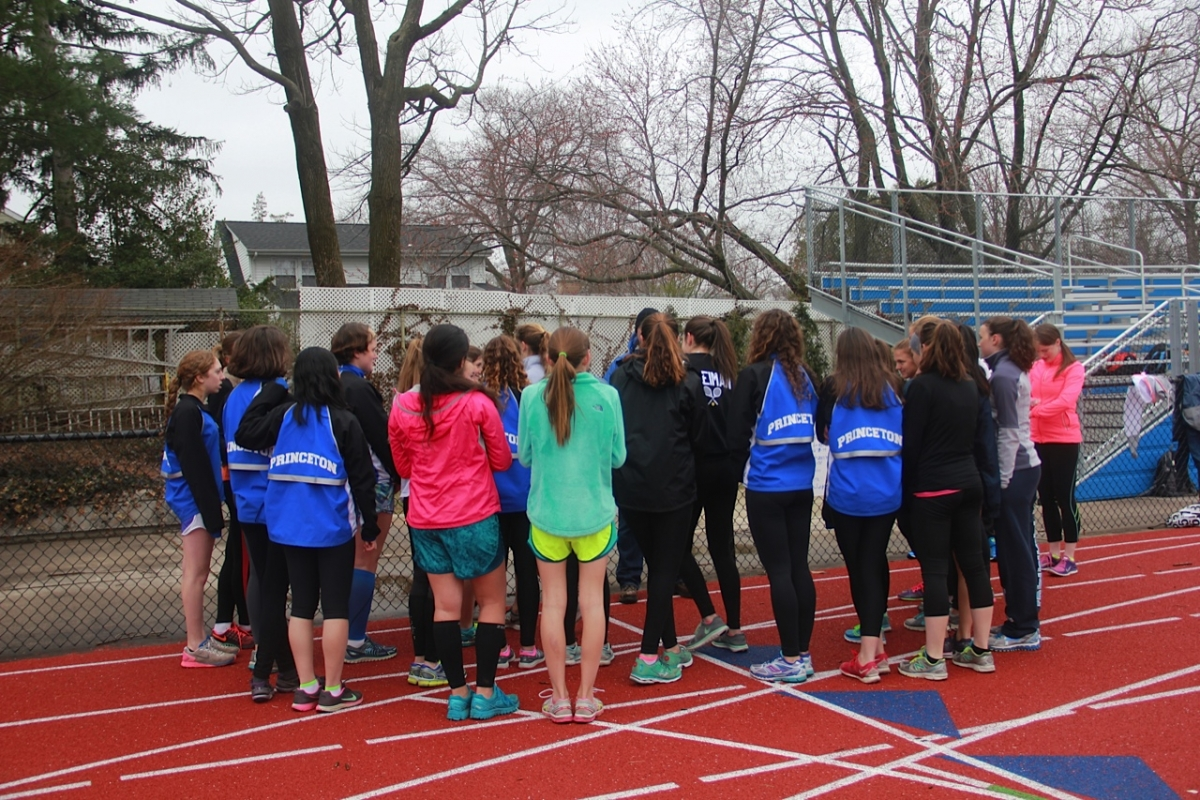 The girls team discusses goals for its upcoming meets at practice on April 9. photo: Amy Wang