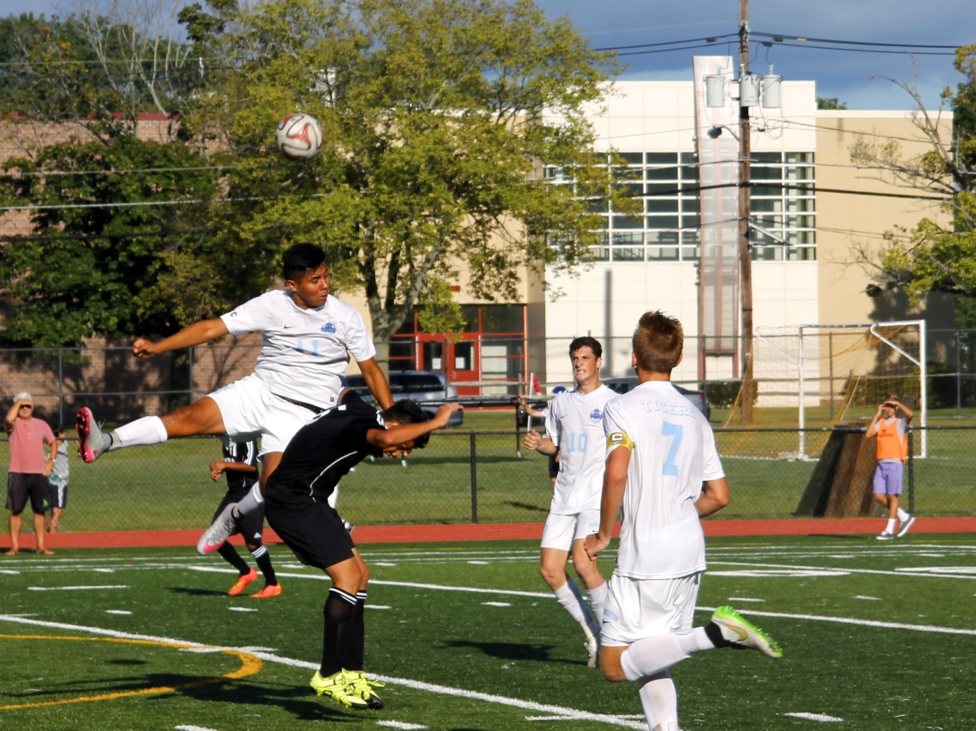 photo: Ashley Dart Co-Captains Pete Luther '16 (right) and Cole Synder '16 (center) look to assist Edgar Morales '16 (left) against Trenton Central High School on Friday, September 11 at the PHS turf. The team won 4–1.