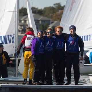 From right, Sophie Corrodi '15, Ashley Dart '16, Harrison Barfield '17, and Nathan Drezner '15 pose for a team photo between races on September 10. Photo: Bentley Drezner