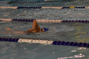 """<span class=""""credit credit- """"><a href=""""/credit/""""Aaron/"""" title=""""View all of this person's work"""">""""Aaron</a></span> Emily Becker '19 swims the 500-meter freestyle against West Windsor-Plainsboro High School South. The team tied with a final score of 85–85."""