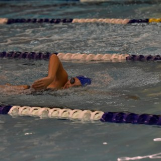 "[credit name = ""Aaron Wu""] Emily Becker '19 swims the 500-meter freestyle against West Windsor-Plainsboro High School South. The team tied with a final score of 85–85."