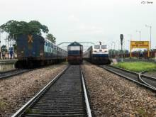 Three in one capture, featuring NGC Alco twins, blocking the single main line, while at left, the rake of New Coochbehar bound Special from New Jalpaiguri awaiting its starter and on the right, EMD WDP-4B from SGUJ Shed in charge with Dibrugarh Town-New Delhi Rajdhani Express.  The location is Dhupguri, North Bengal