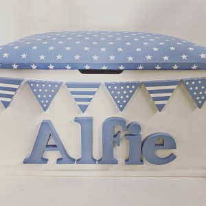 Pastl blue and white boys toy box with spots and stripes bunting and star fabric lid. Can be personailsed with any name