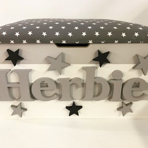 grey and white stripe star toy box featuring grey and black stars