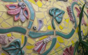 Tile mosaics cover many of the exposed surfaces.