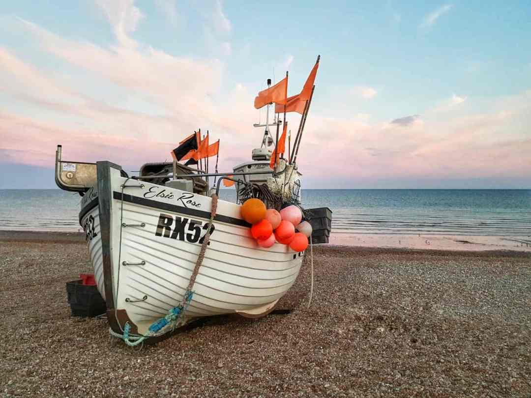 Hastings fishing boat on the beach at sunset