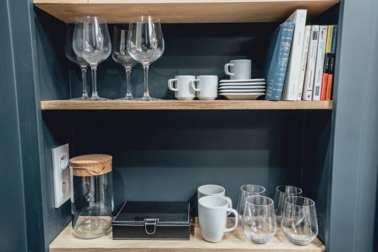 crockery and glasses on shelf