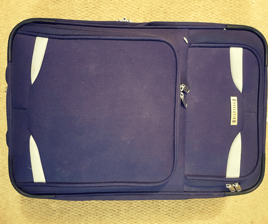 Small Purple Revelation suitcase with silver accents small enough to use as hand luggage for most airlines
