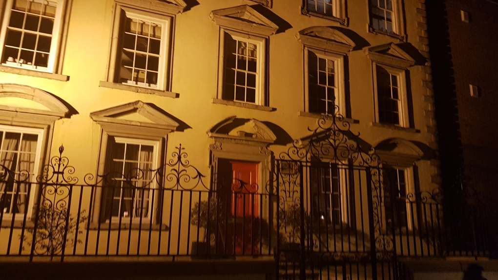 One of the stops on the ghost tour, a white fancy looking house with a metal gate