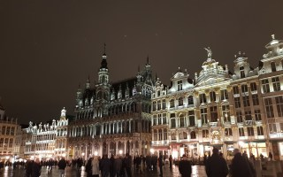 Grand Place in Brussels. A night scene with large ornate buildings lit up