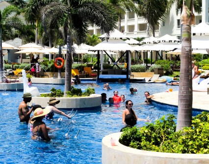 Guests getting their exercise in at the Hyatt Ziva pool