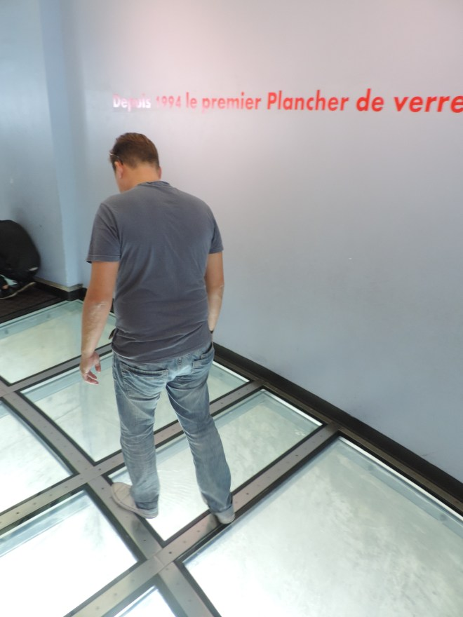 Walking on the glass floor at the CN tower
