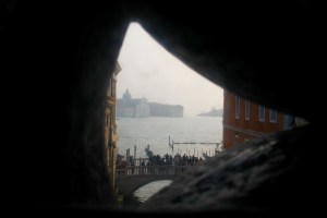 Looking out from the Bridge of Sighs. This view is the one that made the prisoners sigh - Venice, Italy