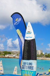 This surfboard has all of the arrivals of the day written on it - Maho Beach, St. Maarten