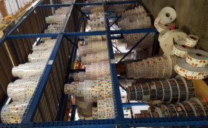 A scrapbookers dream! Shelf after shelf of sticker rolls in their warehouse