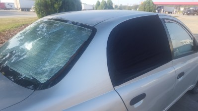 A photo of the outside of our car, showing the rear passenger window covers, and the rear window cover