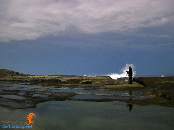 Christian taking photos of waves in Biri Island
