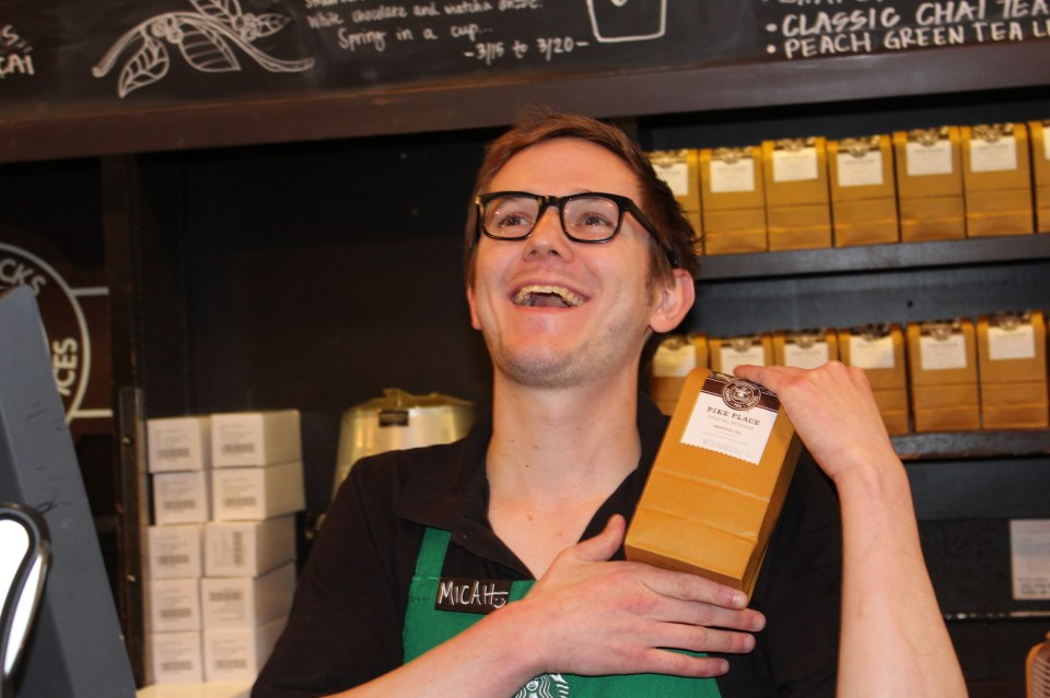 A barista at the original Starbucks store