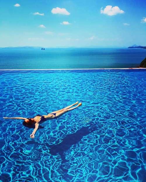 Floating in the infinity pool in Santhiya, Koh Yao Yai