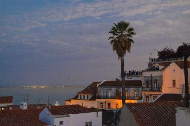 Portas del sol rooftop bar at sunset in Lisbon, Portugal