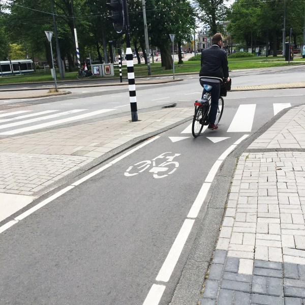 Guy on a bike in a specified bike lane because that's a thing that exists | Biking in the Netherlands | Utrecht | The Travel Medley