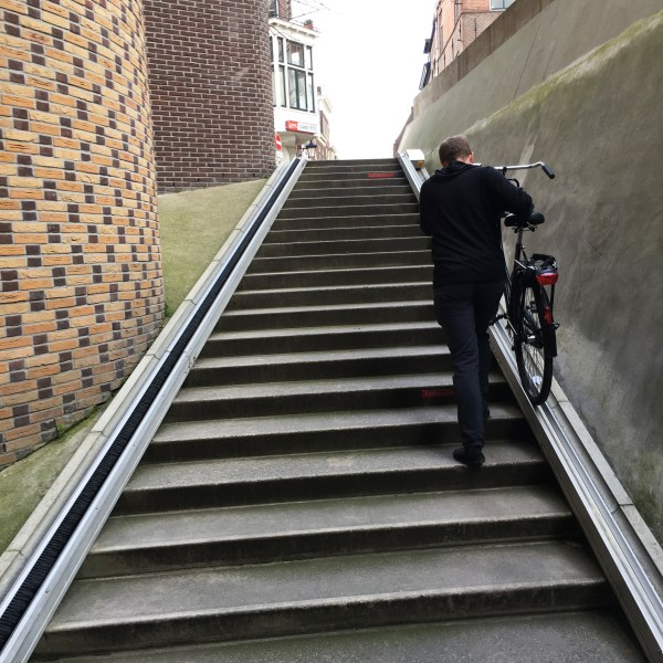 Michael walking his bike up the ramp | Biking in the Netherlands | Utrecht | The Travel Medley
