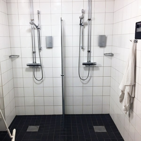 Shower room, with two shower heads hanging on the wall