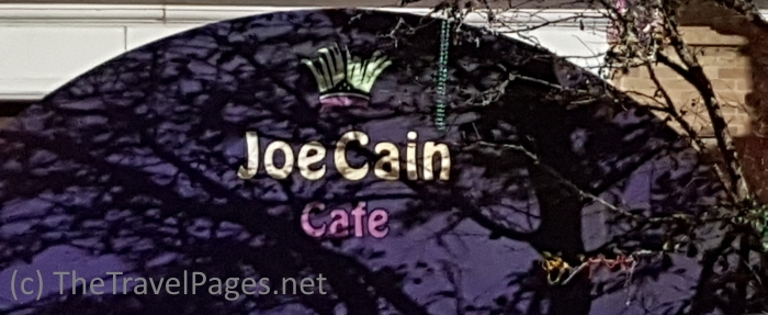 Joe Cain cafe sign in Mobile, Alabama, home of the USA's first Mardi Gras celebrations.