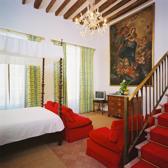 A guest suite at the Dalt Murada, a historic city centre hotel in Palma, Mallorca, Spain, with a view of Palma Cathedral