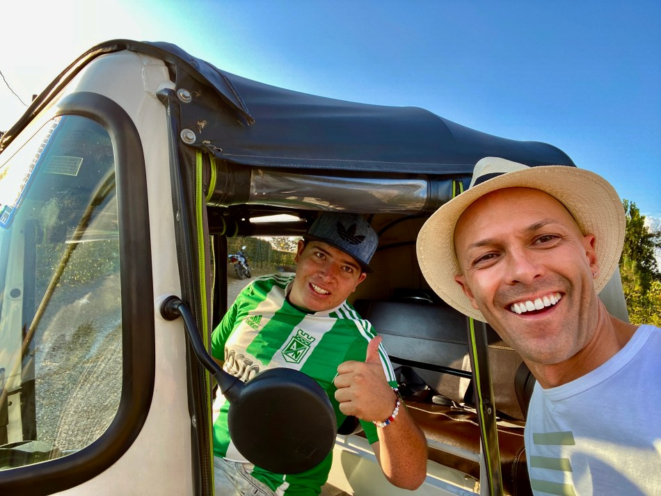 Colombia, Guatape, photo of Dom Nemer and his tuk tuk driver