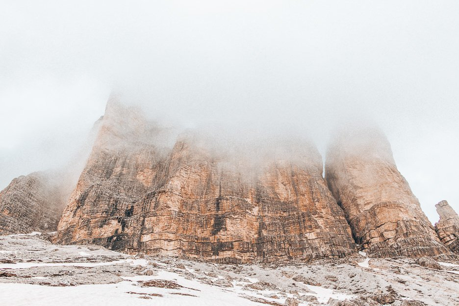 Fog clouding over the peaks of Tre Cime di Lavaredo, The Dolomites, Italy