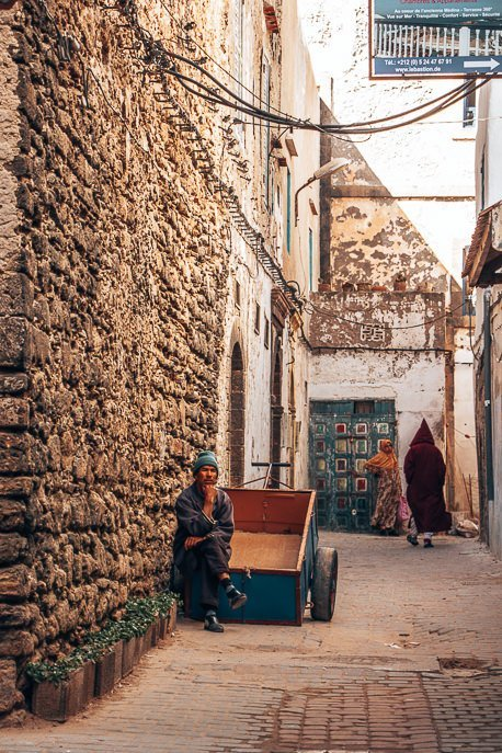 A porter waits to assist travellers with their bags in Essaouira, Morocco