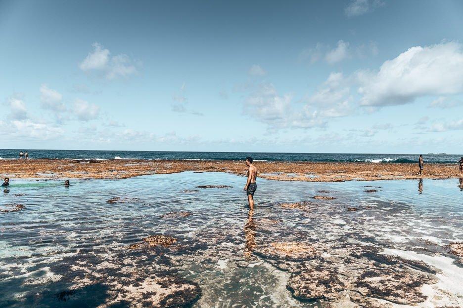 Wading through the shallow rock pools at Magpupungko, Siargao