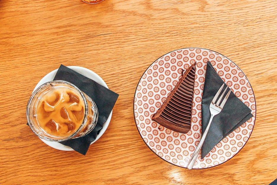 Iced coffee and chocolate cake at La Boheme Cafe, Prague