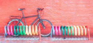 A bicycle against colourful coils and red wall, Copenhagen Denmark