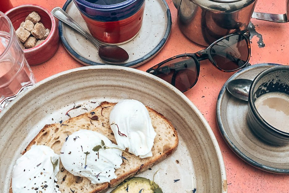 Poached eggs on sourdough with avocado at Farmgirl, Notting Hill