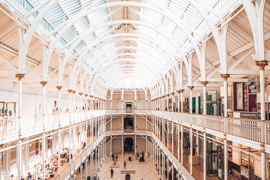 Sunlight streams through the white arches of the National Museum of Scotland, Edinburgh