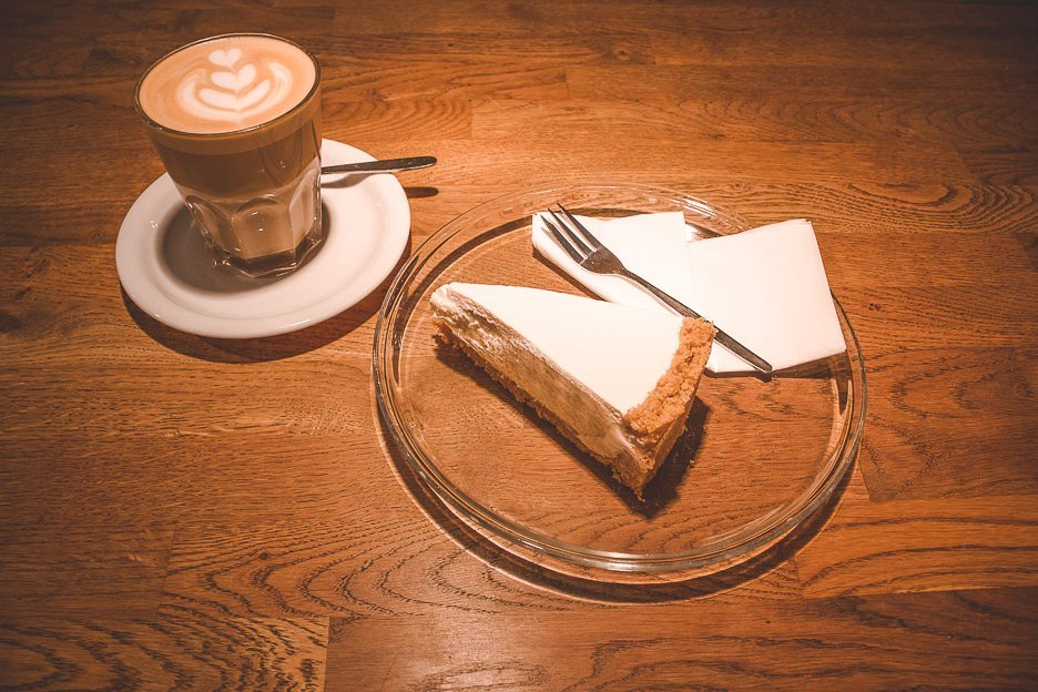 A latte and slice of cheesecake at Five Elephant, Berlin Germany