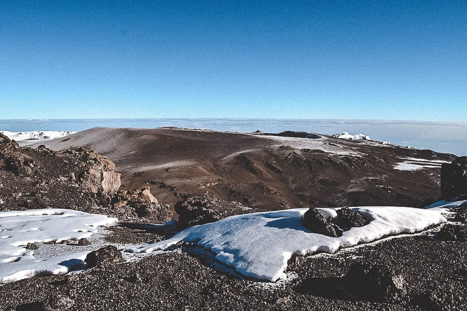 View of the mountains and snow from Uhuru Peak, summit of Kilimanjaro