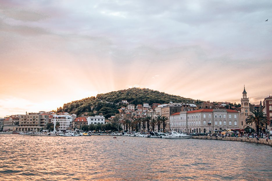 Sunset over the hill from Riva harbourfront, Split Croatia
