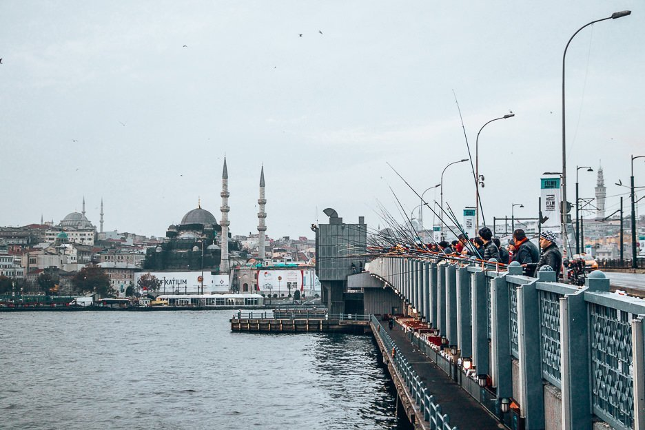 Fisherman wait patiently on Galata Bridge - Istanbul City Guide